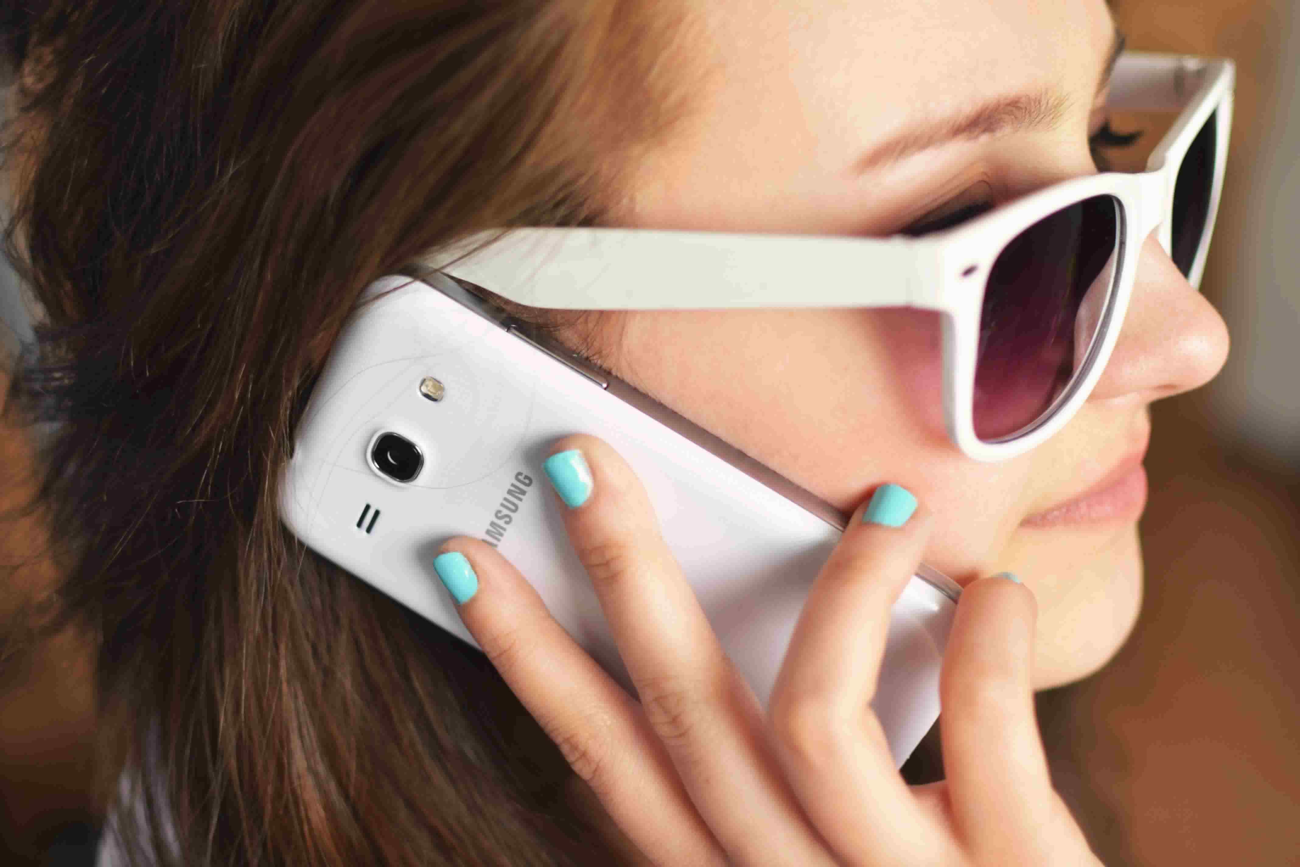 person-sunglasses-woman-smartphone-1